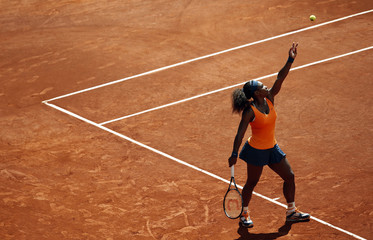Serena Williams of the U.S. serves to Anabel Medina of Spain during their women's singles quarterfinal match at the Madrid Open tennis tournament