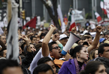 Thousands of followers listen to Mexican leftist Lopez Obrador during a political gathering in Mexico City