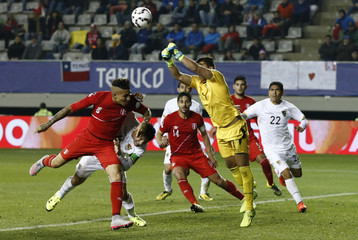 Bolivia's goalie Romel Quinonez saves a ball on a goal attempt by Peru during their Copa America 2015 quarter-finals soccer match at Estadio Municipal Bicentenario German Becker in Temuco