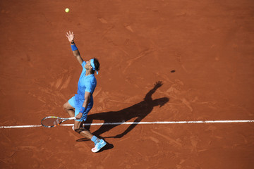 Rafael Nadal of Spain plays a shot to Andrey Kuznetsov of Russia during their men's singles match at the French Open tennis tournament at the Roland Garros stadium in Paris