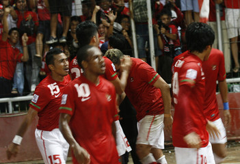 The Indonesian team celebrate Gonzales's goal against Philippines during their second leg semi-final match at the 2010 ASEAN Football Federation