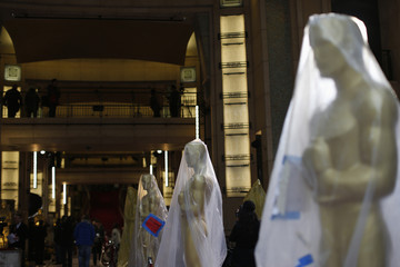 Oscar statues covered with plastic at the entrance to the Dolby Theater during preparations for the 86th Academy Awards in Hollywood