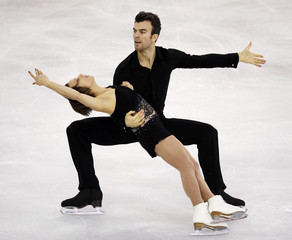 Canada's Meagan Duhamel and Eric Radford perform during the Ice Pairs free skating at the ISU Grand Prix of Figure Skating final in Barcelona