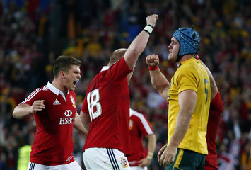 Australia Wallabies' captain James Horwill reacts as the British and Irish Lions players celebrate at full-time at their third and final rugby union test match at ANZ stadium in Sydney,