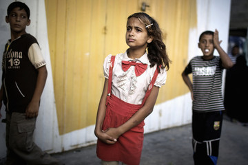 Palestinian children react at the scene of an explosion that medics said killed eight children and two adults, and wounded 40 others at a public garden in Gaza City