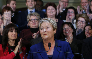 Quebec's Premier Pauline Marois smiles during a news conference before calling an election at the National Assembly in Quebec City
