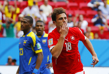 Switzerland's Mehmedi celebrates after scoring a goal during their 2014 World Cup Group E soccer match against Ecuador at the Brasilia national stadium in Brasilia