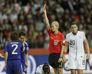 Referee Steinhaus of Germany shows a red card to Iwashimizu of Japan during the Women's World Cup final soccer match between Japan and the U.S. in Frankfurt
