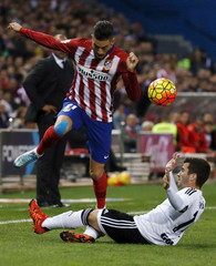Atletico Madrid's Ferreira-Carrasco and Valencia's Gaya fight for the ball during their Spanish first division soccer match in Madrid