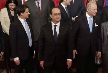 French President Hollande and government members leave following a family photo after the first weekly cabinet meeting of the year at the Elysee Palace in Paris