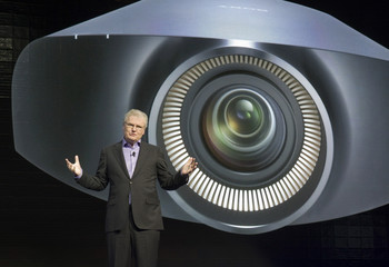 Sony CEO Howard Stringer speaks in front of an image of Sony's 4K home theater projector during a Sony news conference in Las Vegas