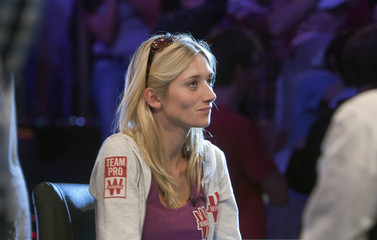 Gaelle Baumann of France sits in her chair after getting knocked out of the World Series of Poker's $10,000 buy-in, no-limit Texas Hold'em main event at the Rio Hotel & Casino in Las Vegas