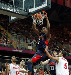 Durant of the U.S. dunks against Tunisia during their men's preliminary round Group A basketball match at the Basketball Arena during the London 2012 Olympic Games