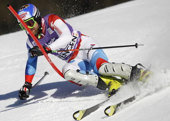 Vogel of Switzerland clears a gate during the second run of the men's Alpine skiing World Cup slalom race in Wengen