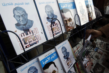 A bookseller displays books about Hosni Mubarak in Cairo