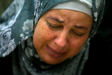 The mother of 16-year-old Palestinian teenager Mohammed Abu Khudair, who was killed in Jerusalem, cries after a court sentenced one of her son's murderers, Yosef Ben-David, to life in prison at Jerusalem's District Court