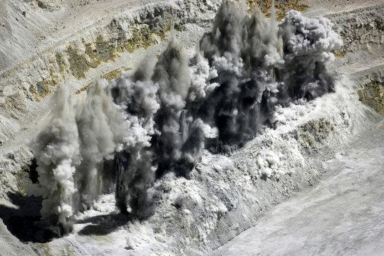 FILE PHOTO: Dynamite explosions blast rock mass at La Escondida, the world's biggest copper mine, near Antofagasta