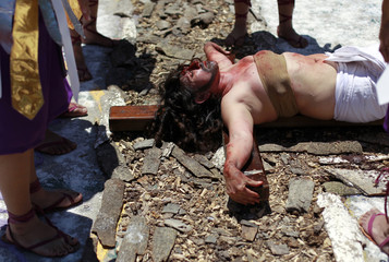 Inmate Claudia Portillo, playing the role of Jesus Christ, takes part in a Via Crucis re-enactment on Good Friday at the women's prison facilities in San Salvador