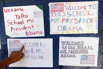 A student points to drawings made at the United States of America School Center in the village of Comasagua