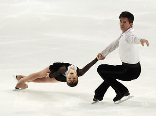 Takahashi and Tran of Japan perform during the pairs short program competition at the ISU Four Continents Figure Skating Championships in Taipei