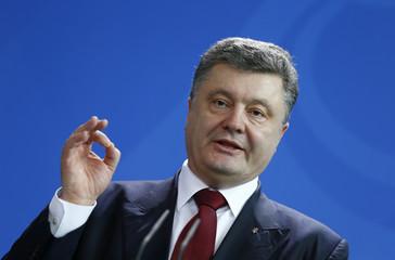 Ukrainian President Poroshenko addresses news conference following talks in Berlin