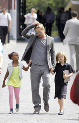 U.S. actor Brad Pitt walks with his daughters Shiloh and Zahara near the Kremlin in Moscow