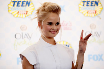 Debby Ryan arrives at the Teen Choice Awards 2014 in Los Angeles