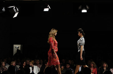 Models present creations from the 2011 spring/summer collection for business wear by Astibo during a fashion show in Skopje