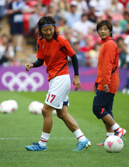 Japan's Yuki Ogimi warms up with her team mates in their women's soccer final gold medal match against the U.S. at Wembley Stadium during the London 2012 Olympic Games