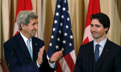 United States Secretary of State Kerry applauds Canadian Prime Minister Trudeau during working lunch at the State Department in Washington