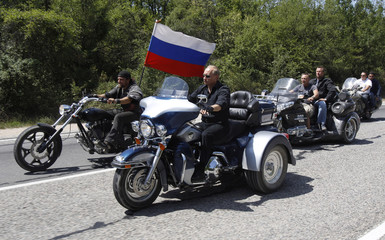 Russia's PM Putin rides a Harley Davidson as he visits a camp of Russian and Ukrainian bikers near Sevastopol in Ukraine's Crimea
