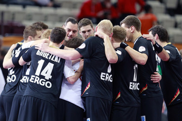 Germany's players celebrate after their preliminary round of the 24th men's handball World Championship match against Argentina in Doha