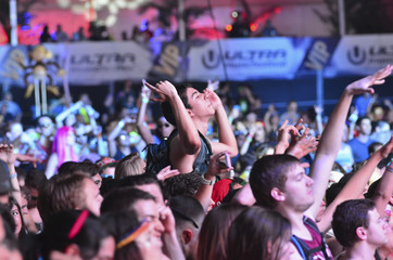 A crowd moves to the beat of electronic music during the Ultra Music Festival at Bayfront Park in Miami