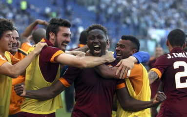 AS Roma's Yanga-Mbiwa celebrates with his team mates after scoring against Lazio during their Serie A soccer match at the Olympic stadium in Rome