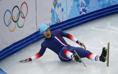 France's Maxime Chataignier crashes out during the men's 1,000 metres short track speed skating heats at the Iceberg Skating Palace during the 2014 Sochi Winter Olympics