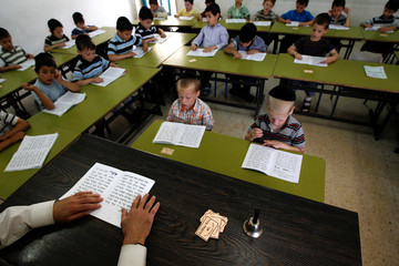 Ultra Orthodox students attend a religious studies class at Kehilot Yaacov Torah School for boys in Ramot neighbourhood in Jerusalem