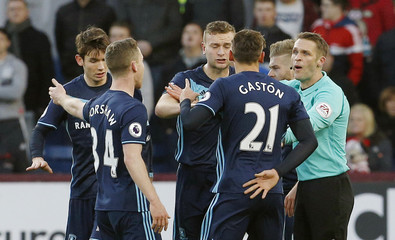 Middlesbrough's Adam Forshaw and Gaston Ramirez with referee Craig Pawson