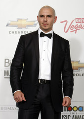 Rapper Pitbull poses in the photo room during the 2011 Billboard Music Awards show in Las Vegas