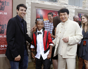 "Cast members Chan and Smith pose with actor Macchio at the premiere of ""The Karate Kid"" at the Mann Village theatre in Los Angeles"