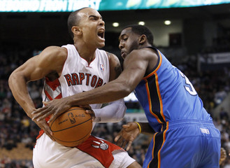 Raptors Bayless drives to the basket against Thunder White during their NBA basketball game in Toronto