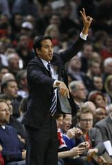 Miami Heat head coach Erik Spoelstra signals a play during first quarter of their NBA basketball game against the Portland Trail Blazers in Portland