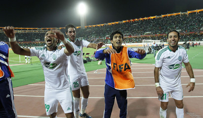 Players of Morocco's Raja Casablanca celebrate their team's goal against Mexico's Monterrey at extra time during their FIFA Club World Cup soccer match at Stade Adrar stadium in Agadir