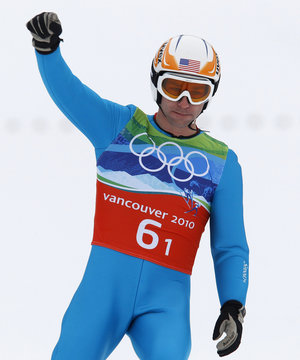 Brett Camerota of the U.S. reacts after his jump during the large hill ski jumping portion of the Nordic Combined Team event at the Vancouver 2010 Winter Olympics in Whistler