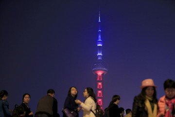 Oriental Pearl TV Tower is lit up in blue, white and red, the colors of the French flag, following the Paris attacks, in Shanghai