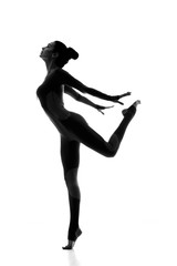 Free and healthy. Silhouette of a elegant fit female gymnast posing gracefully