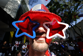 A U.S. fan watches the broadcast of the 2014 World Cup Group G soccer match between the U.S. and Germany in Belo Horizonte