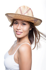 Multi-ethnic Asian woman in straw hat smiling looking beautiful