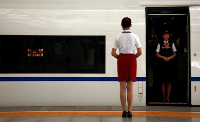A conductor stands in a new high-speed train before it departs from the Beijing-South railway station for Shanghai as part of an official trip for members of the media