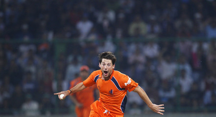 The Netherlands' Pieter Seelaar celebrates taking the wicket of India's Yusuf Pathan during their ICC Cricket World Cup group B match in New Delhi