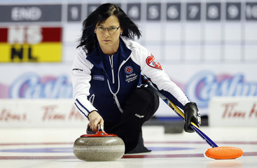 Nova Scotia skip Arsenault throws a rock against Newfoundland andLabrador during the eleventh draw at Scotties Tournament of Hearts curling championship in Kingston